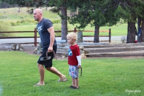 Britton teaching Bodie how to play horse shoes.