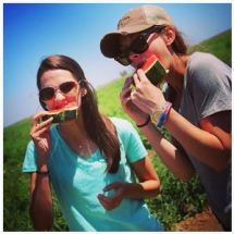 My sister Laura and I eating watermelon when my family came to visit me in California.