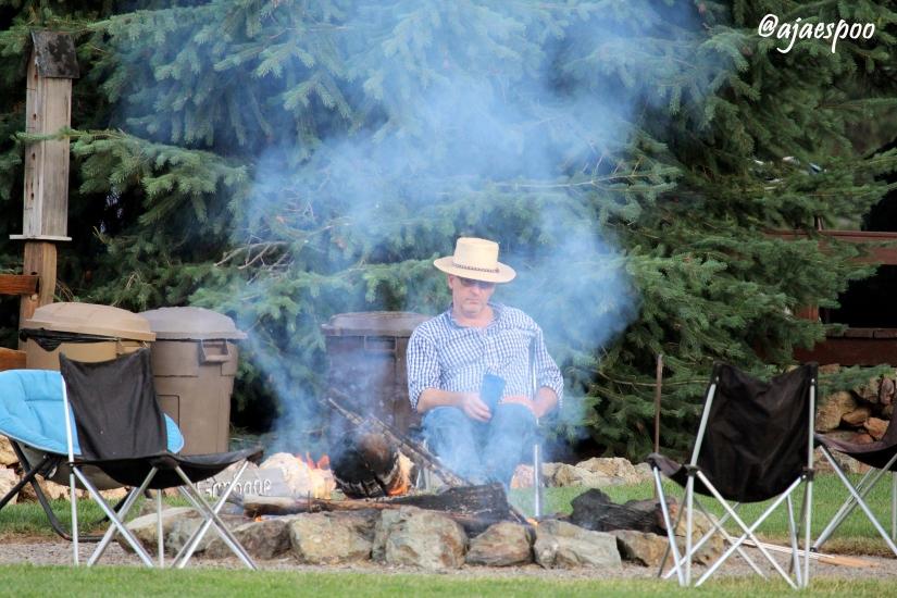 dad at campfire with namemark